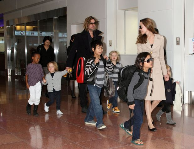 Angelina Jolie and Brad Pitt with their children ~~ Haneda International airport, Tokyo, Japan - 08 Nov 2011