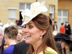 31-year-old royal wears a canary yellow coat to the annual Buckingham Palace Garden Party.