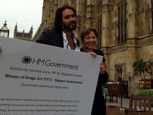 Russell Brand and Caroline Lucas outside the Houses of Parliament