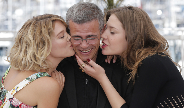 Lea Seydoux, director Abdellatif Kechiche, and Adele Exarchopoulos pose for photographers during a photo call for the film La Vie D'Adele / Blue is the Warmest Colour at Cannes 2013