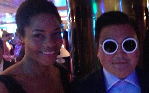Naomie Harris poses with a fake Psy