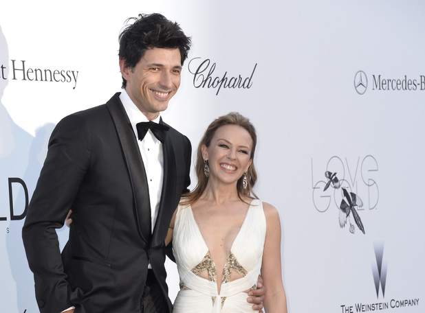 Kylie Minogue, Andres Velencoso, amfAR Cinema Against AIDS benefit at the Hotel du Cap-Eden-Roc, Saint Laurent dress cutout detail