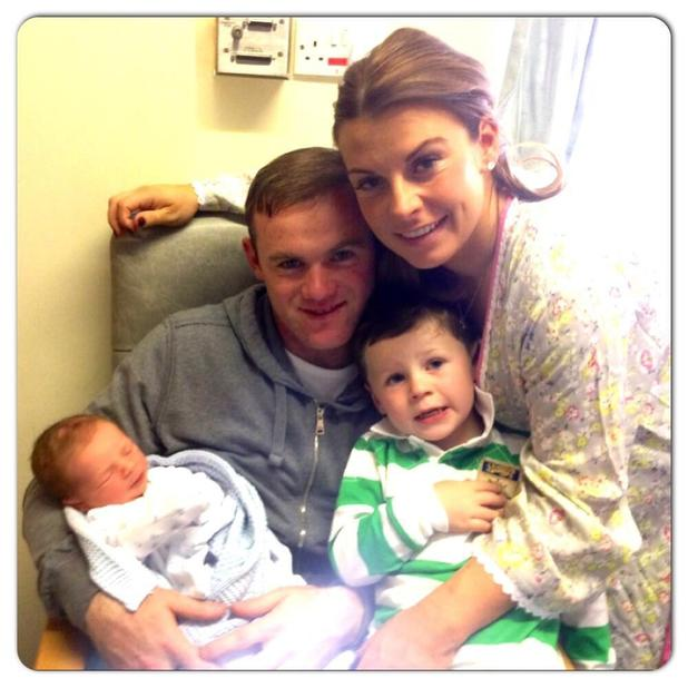 Wayne and Coleen Rooney with their son Kai and newborn Klay.