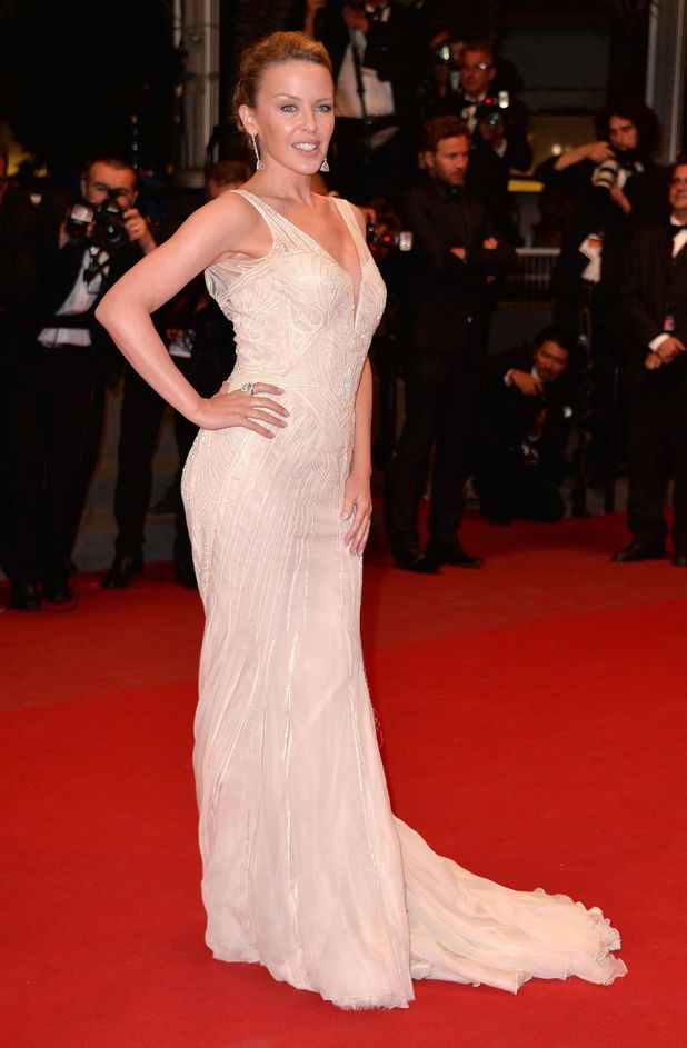 Kylie Minogue tuns in a floor-length embroidered Roberto Cavalli gown as she arrives at The Great Beauty