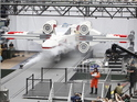 Thousands gather in New York City's Times Square to watch the unveiling of the world's largest LEGO Model, a 1:1 replica of the LEGO Star Wars X-wing Starfighter that took 32 Model Builders, 5.3 million LEGO bricks and over 17,000 hours to complete, Thursday May 23, 2013.