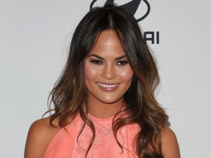 Chrissy Teigen arrives at the Clive Davis Pre-GRAMMY Gala on Saturday, Feb. 9, 2013