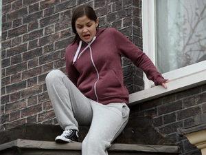 Lauren escapes through her bedroom window.