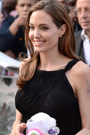 Angelina Jolie carries a gift given to her.