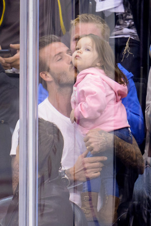 David Beckham kisses his daughter Harper at an NHL playoff game between the San Jose Sharks and the Los Angeles King