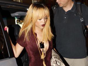 Rihanna, velvet jumpsuit, snakeskin clutch, Paris