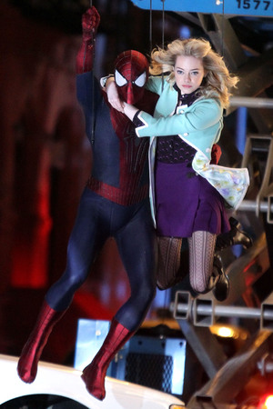 Andrew Garfield and Emma Stone film an action scene on location for the film 'The Amazing Spiderman 2' on June 4, 2013 in New York City.