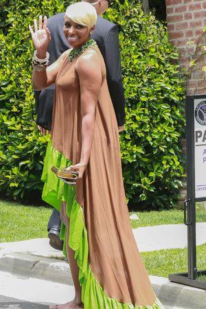 NeNe Leakes attending Kim Kardashian's baby shower