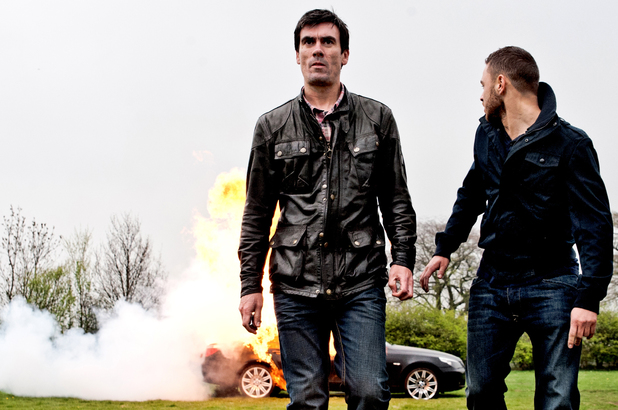 6579: Cain and Adam walk away after setting the car on fire it explodes behind them
