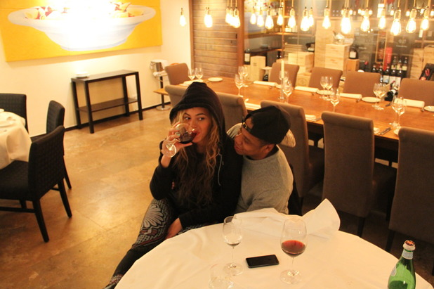 Beyoncé sips a glass of wine with Jay-Z
