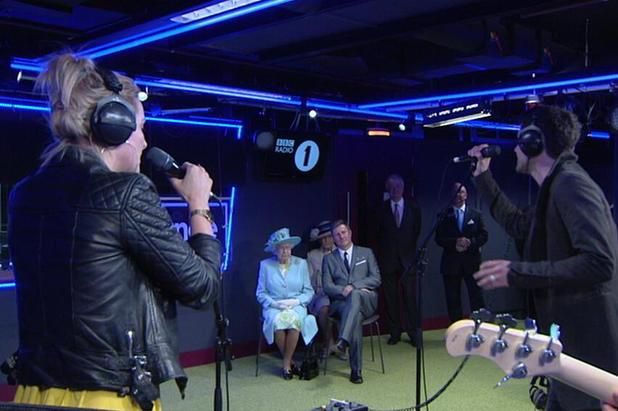 The Queen listens to The Script in the BBC Radio 1 Live Lounge