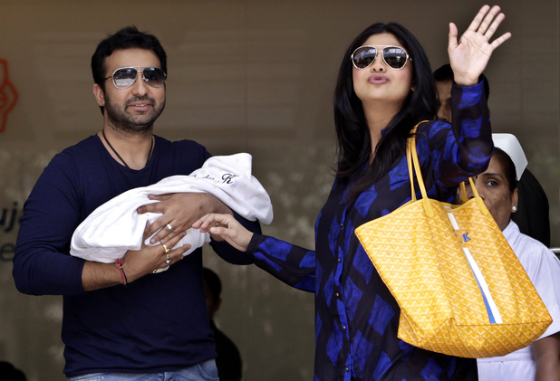 Shilpa Shetty and her husband Raj Kundra pose with their newborn baby boy outside a hospital in Mumbai in May 2012.