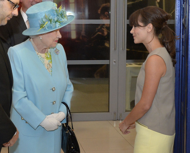 Queen Elizabeth II talks to Jenna Louise Coleman during a visit to officially open the BBC's Broadcasting House