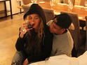 Beyoncé uploads a picture of herself quaffing a glass of red wine to her Tumblr.