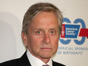 Michael Douglas shrugs off split as gossip during press for Behind the Candelabra.
