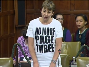 Caroline Lucas wears a 'No More Page Three' T-Shirt