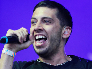 Example performs at Parklife Festival 2013 in Manchester