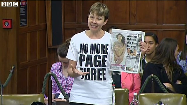 Caroline Lucas brandishes Page 3 of 'The Sun'