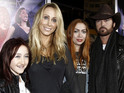 Tish Cyrus cites irreconcilable differences in her divorce petition.