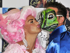 Katie Price dresses as panto princess, kisses 'frog' at latest book launch.