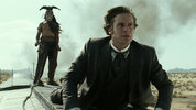 John Reid (Armie Hammer) and Tonto (Johnny Depp) battle some bandits on the roof of a train.