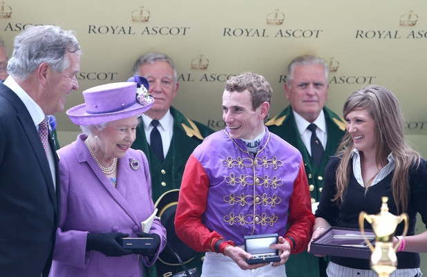 Queen Elizabeth II with Sir Michael Stoute and Ryan Moore