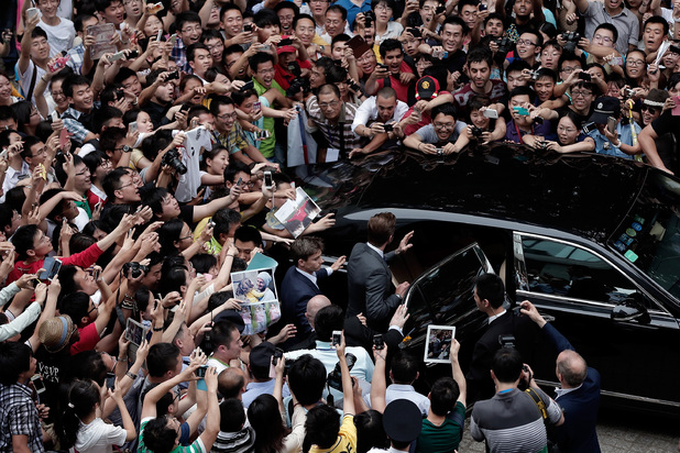 David Beckham is surrounded by fans as he visits Tongji University