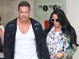 Katie Price, Keiran Hayler, leaves the BBC Radio 1 studios carrying a copy of her latest book 'He's The One'