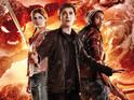 Logan Lerman and Alexandra Daddario stand ready in the sequel's poster.