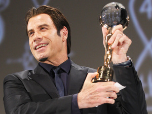 John Travolta receives the Lifetime Achievement Award at 48th International Film Festival in the Czech Republic.