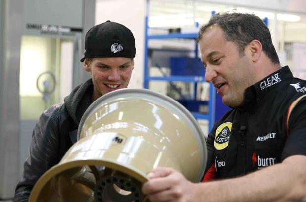 Avicii tests Lotus F1 Team's vehicle.