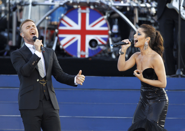 Gary Barlow and Cheryl Cole perform at the Queen's Jubilee Concert in front of Buckingham Palace