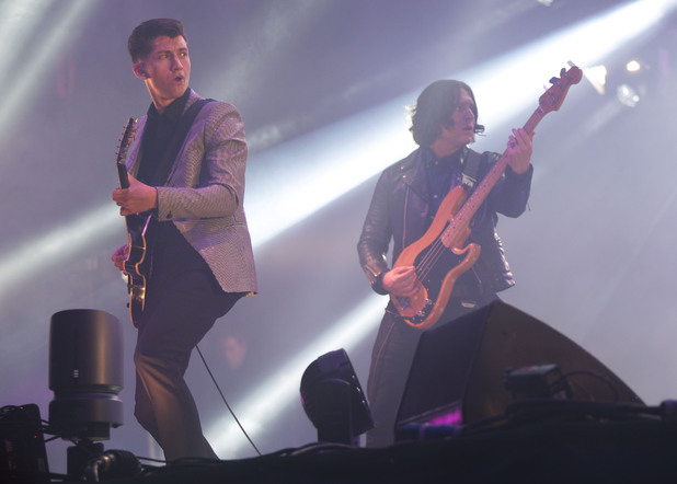 Alex Turner and Nick O'Malley of the Artic Monkeys performing on the Pyramid Stage, during the first performance day of the Glastonbury 2013