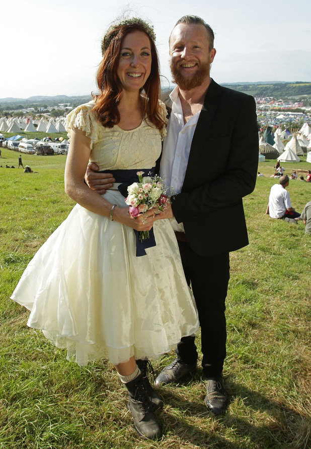 Newly-wed festival goers John and Mathilda Fristrom Eldridge, from Newquay, enjoy taking their honeymoon at the Glastonbury Festival
