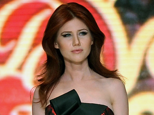 Anna Chapman walks the runway at a Turkish fashion show in June 2012