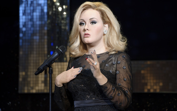 Final touches are made to the waxwork model of Adele at Madame Tussauds