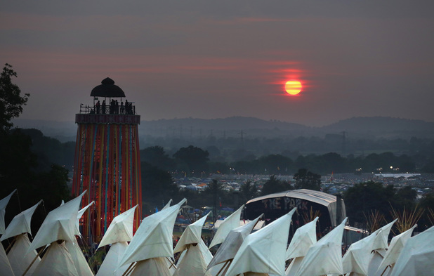 GLASTONBURY, ENGLAND - JUNE 26: The sun begins to set over tipis at the Glastonbury Festival of Contemporary Performing Arts site at Worthy Farm, Pilton on June 26,