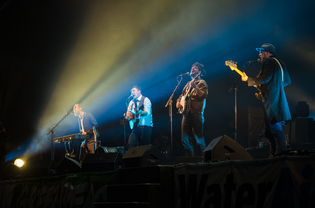 Ben Lovett, Marcus Mumford, Winston Marshall and Ted Dwane of Mumford & Sons perform on the Pyramid Stage during day 4 of the 2013 Glastonbury Festival