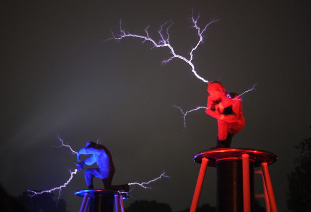 Performers conduct electricity during the Glastonbury 2013 Festival of Contemporary Performing Arts at Pilton Farm, Somerset.