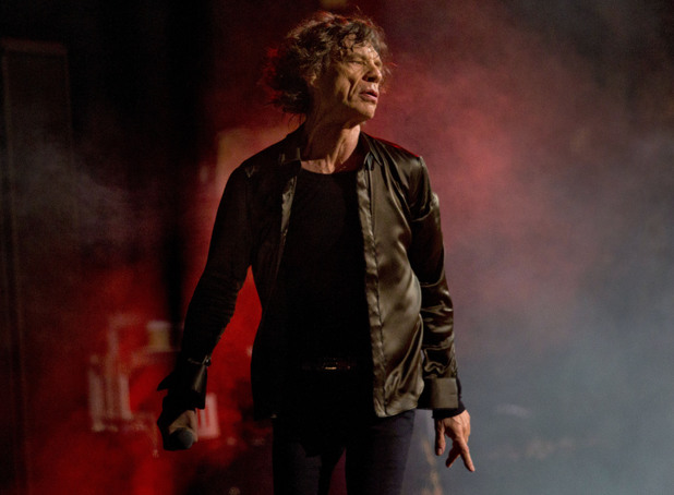 Mick Jagger of British band the Rolling Stones performs on the Pyramid main stage at Glastonbury, England, Saturday, June 29, 2013 Thousands of music fans have arrived for the festival to see headliners, Arctic Monkeys, Mumford and Sons and the Rolling Stones.