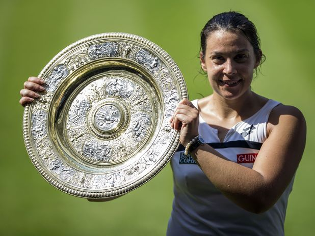 France's Marion Bartoli with the trophy after beating Germany's Sabine Lisicki