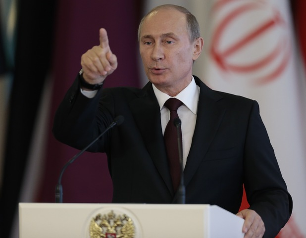 Russian President Vladimir Putin speaks at a news conference