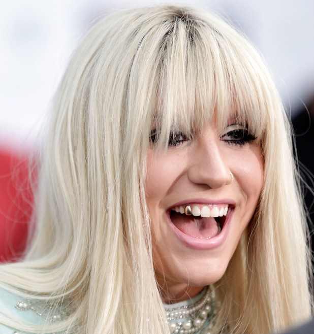 Ke$ha, teeth, gold