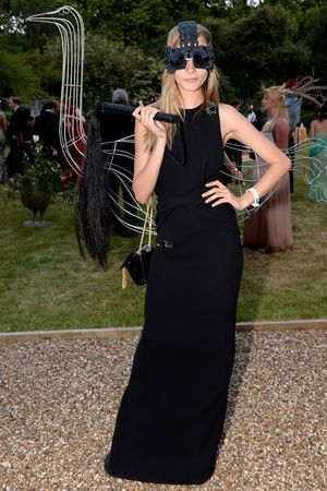 Model and actress Cara Delevingne poses as she attends a reception hosted by The Prince of Wales and Duchess of Cornwall, a charity working to save the Asian Elephant from extinction in the wildat Clarence House on July 09, 2013 in London, England.