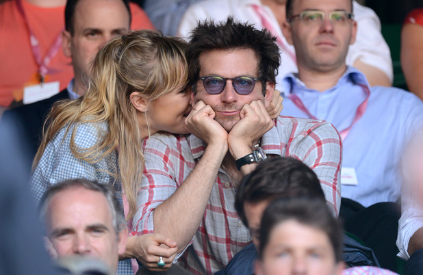 Suki Waterhouse and Bradley Cooper attend the Jerzy Janowicz vs Andy Murray match on Day 11 of the Wimbledon Lawn Tennis Championships at the All England Lawn Tennis and Croquet Club on July 5