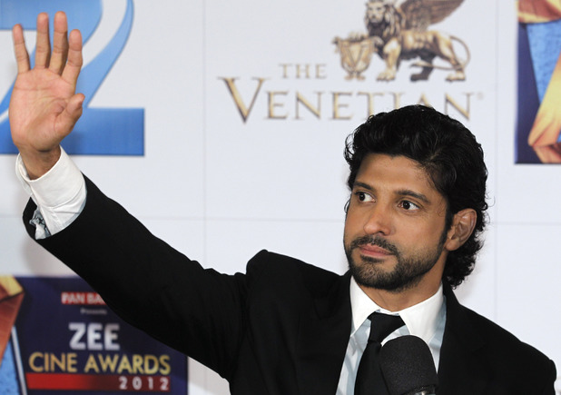 Farhan Akhtar waves on the red carpet of the Zee Cine Awards 2012 in Macau Saturday, Jan. 21, 2012.